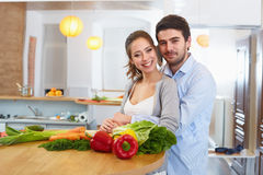 Young Сouple Сooking in The Kitchen. Healthy food Royalty Free Stock Photography