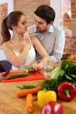 Young Сouple Сooking in Еhe Kitchen. Healthy food Stock Images