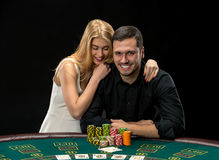 Young сouple playing poker have a good time in casino Stock Photo