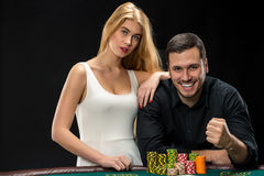 Young сouple playing poker and have good time in casino Stock Images