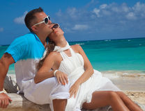 Young outdoor fashion portrait of beautiful couple on vacation Royalty Free Stock Photo