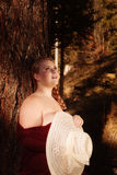 Young, overweight, blond woman with naked shoulder enjoys the sun Royalty Free Stock Images