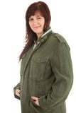 Young overweight woman in military jacket Stock Images