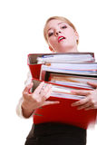 Young overworked business woman holding stack folders documents. Business and paperwork. Young overworked businesswoman holding stack of folders documents. Busy Royalty Free Stock Photo