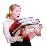 Young overworked business woman holding stack folders documents Royalty Free Stock Photos