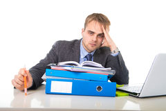 Young overworked and overwhelmed businessman in stress leaning on office folder exhausted and depressed royalty free stock photos