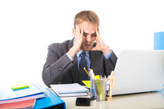 Young overworked and overwhelmed businessman suffering stress and headache Stock Photography