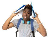 Young overworked and stressed university black afro american student on his 20s. Posing with backpack and notepad isolated background in education stress and Stock Photo
