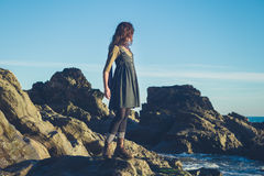 Young owman standing on shore Stock Images