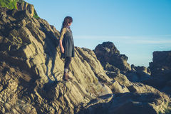 Young owman standing on shore Royalty Free Stock Photos