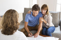 Young owners couple meeting realtor for apartment investment. Stock Images