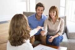 Young owners couple receive the keys of their new house Royalty Free Stock Images