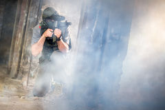 Young paintball in smoke Stock Photos