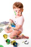 Young Painter. Portrait of baby girl with painting colors. Isolated on white background stock image