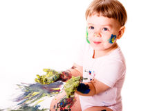 Young painter with dirty hands. Child showing her palms colored with yellow paint stock photos