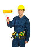 Young painter man holding paint roller. Young painter man in uniform holding paint roller isolated on white background royalty free stock photography