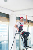The young painter painting the ceiling in construction concept Stock Images