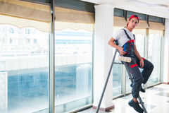 The young painter painting the ceiling in construction concept Stock Image