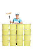 Young painter posing behind color buckets Royalty Free Stock Photos