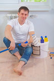 A young painter sitting on the floor Stock Photography