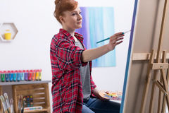 Young painter at work in her studio royalty free stock photography