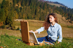 Young painter at work in the mountains Royalty Free Stock Photography