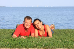 Young pair. Joyful young pair is overlaping shore of the lake royalty free stock image
