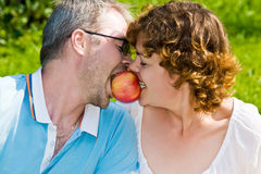 Young pair bites apple Stock Photography