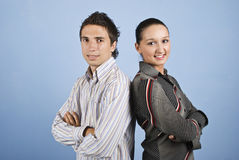 Young pair of business people smiling Royalty Free Stock Photography