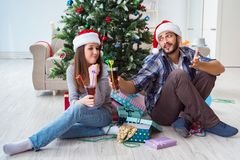 The young pair in conflict situation during christmas night Stock Image