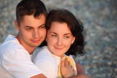 Young pair embraces on beach Stock Photography