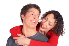 Young pair embraces and smiles stock photography