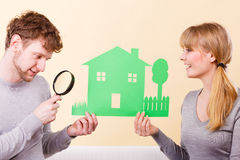 Young pair give attention to details. Housing real estate family future finances concept. Young pair give attention to details. Just married men with women Royalty Free Stock Images