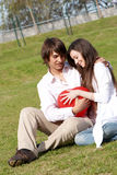 Young pair on a glade in park Stock Image
