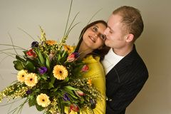 Young pair  happyness with bouquetin love and. Young pair in love and happyness with flower bouquet in hand Royalty Free Stock Photo