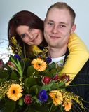 Young pair  happyness with bouquetin love and. Young pair in love and happyness with bouquet Royalty Free Stock Images