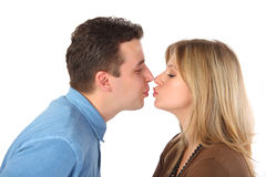 Young pair kisses Stock Images