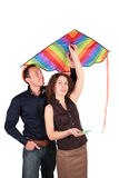 Young pair with kite. On white stock images