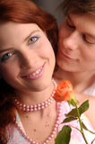 The young pair in love with rose Stock Images