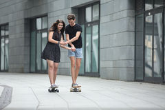 Young pair in love of stylish teenagers ride Royalty Free Stock Images