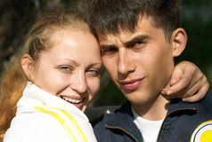 Young pair of lovers embrace. Young beautiful pair of lovers embrace on open-air Stock Images