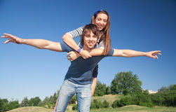 Young pair play in airplane Stock Images