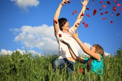 Young Pair Scatters Petals Of Roses Stock Photography