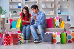 The young pair after shopping with many bags. Young pair after shopping with many bags Royalty Free Stock Image