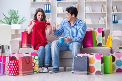 The young pair after shopping with many bags. Young pair after shopping with many bags Stock Photo