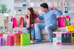 The young pair after shopping with many bags. Young pair after shopping with many bags Royalty Free Stock Photos