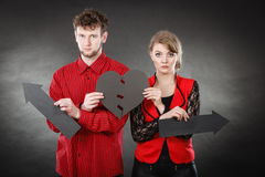 Young pair showing heartbreak symbols. Stock Photography