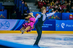 Young pair skaters on ice sports arena Stock Images