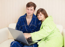 Young pair on sofa with laptop Stock Image