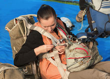 The young parachutist dresses a parachute Stock Photos